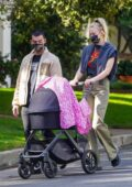 Sophie Turner wears a t-shirt and flared pants while out on a stroll with Joe Jonas and their daughter Willa in Los Angeles