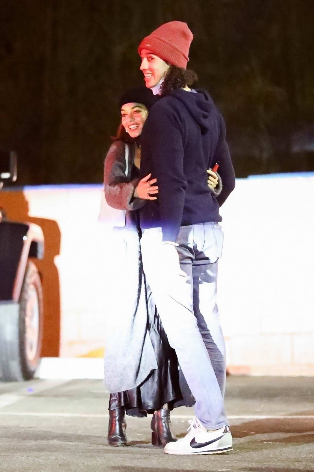 Vanessa Hudgens is all smile as she hugs her new boyfriend Cole Tucker while out for dinner in Los Angeles
