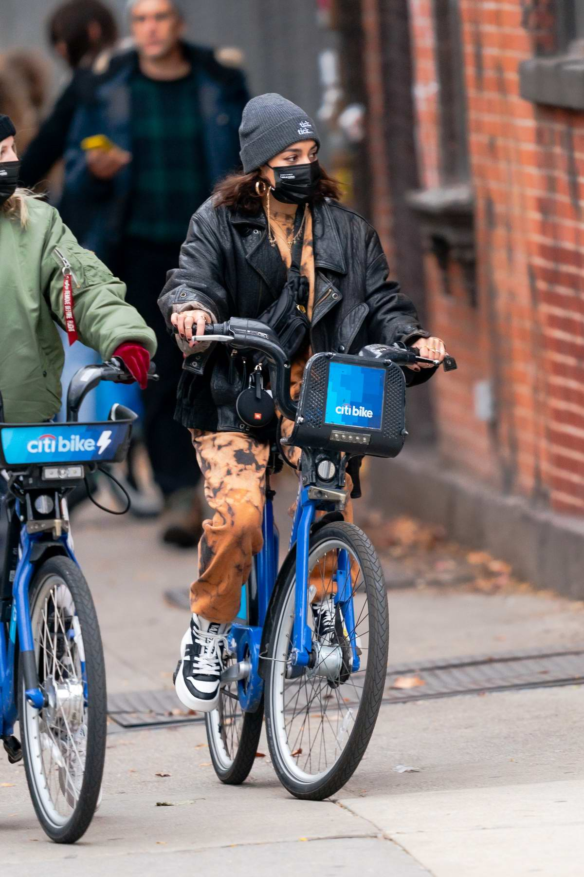 Vanessa Hudgens sports tie-dye sweats while riding around on a Citi Bike with BFF GG Magree in New York City