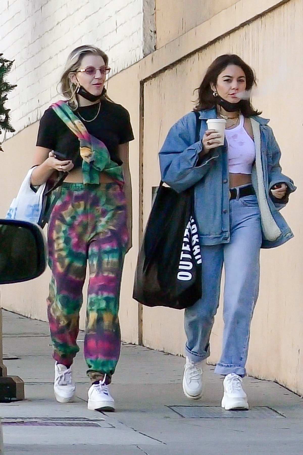 Vanessa Hudgens steps out in double denim during a shopping trip with BFF GG Magree in Burbank, California