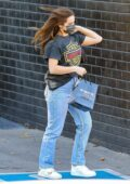 Addison Rae keeps it casual with a tee and jeans while out jewelry shopping at XIV Karats in Beverly Hills, California