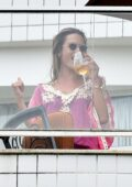 Alessandra Ambrosio sips on wine while having lunch with her family on Christmas in Florianópolis, Brazil