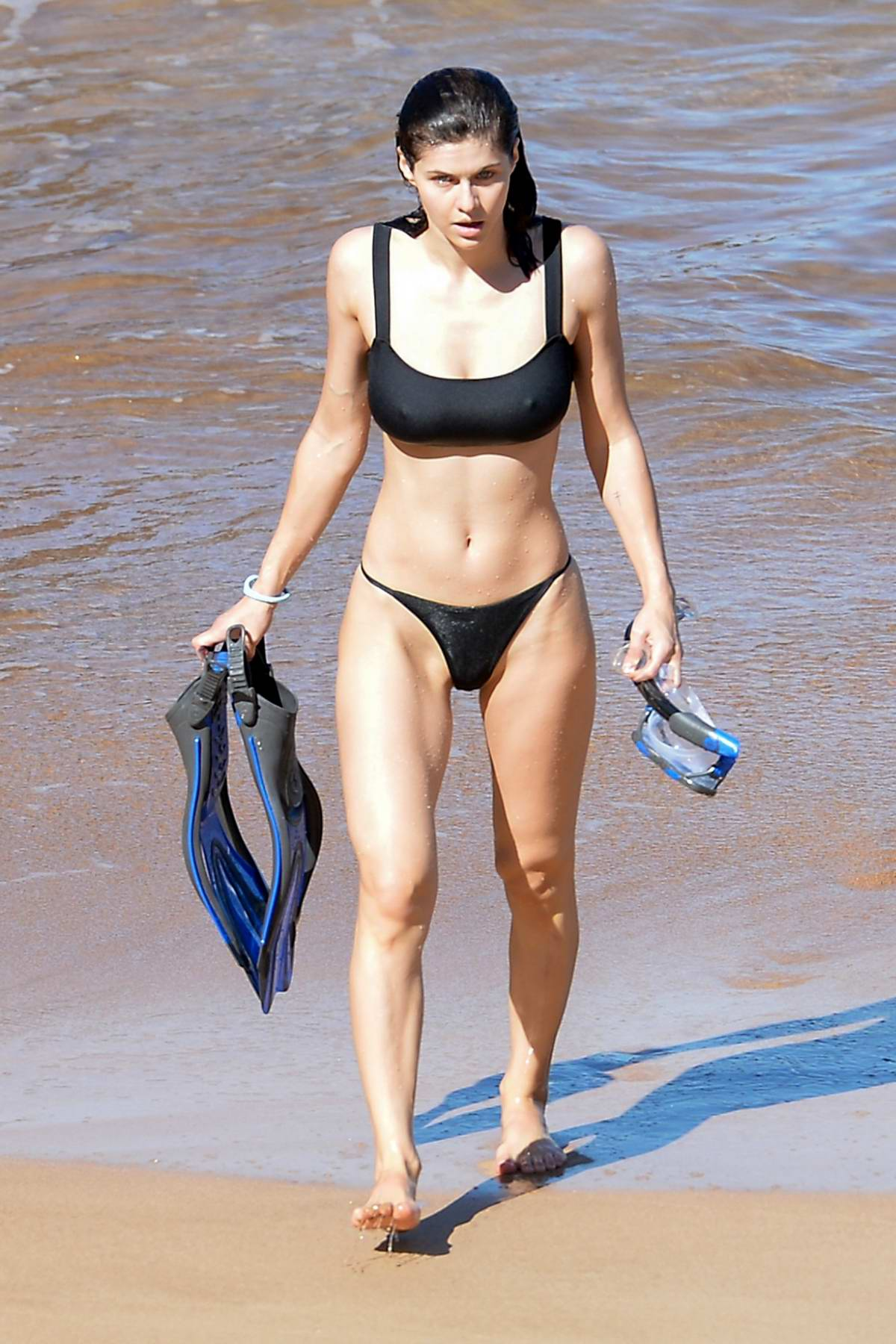 Alexandra Daddario smolders in a black bikini as she hits the beach in Maui, Hawaii