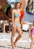 Alexis Ren looks incredible in a light blue bikini as she enjoys the beach with her boyfriend in St Barts, France