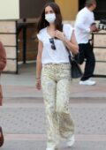 Ana de Armas dons a white top and paisley print denim while shopping for Christmas presents in Santa Monica, California