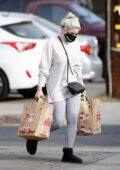 Ariel Winter dons a beige sweatshirt and leggings during a grocery run at Trader Joe's in Los Angeles