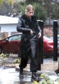 Ashley Benson steps out in a black trench coat while making a stop at Starbucks on a rainy day in Los Angeles