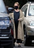 Ashley Tisdale wears a trench coat on a cold coffee run at The Coffee Bean & Tea Leaf in Los Feliz, California