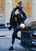 Bella Hadid rocks a North Face jacket with a sports bra and leggings as she heads to the gym in New York City
