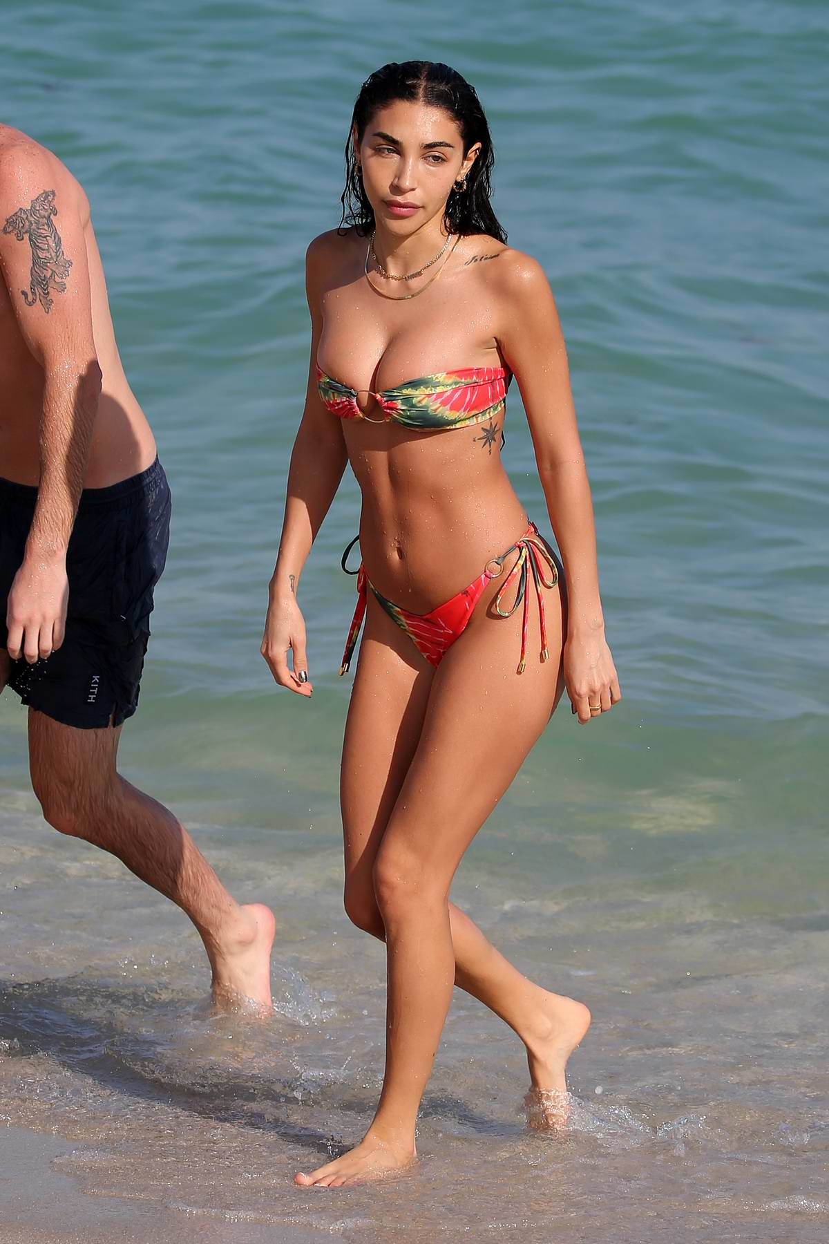 Chantel Jeffries slips into a colorful bikini while enjoying a relaxing beach day with boyfriend Andrew Taggart in Miami, Florida