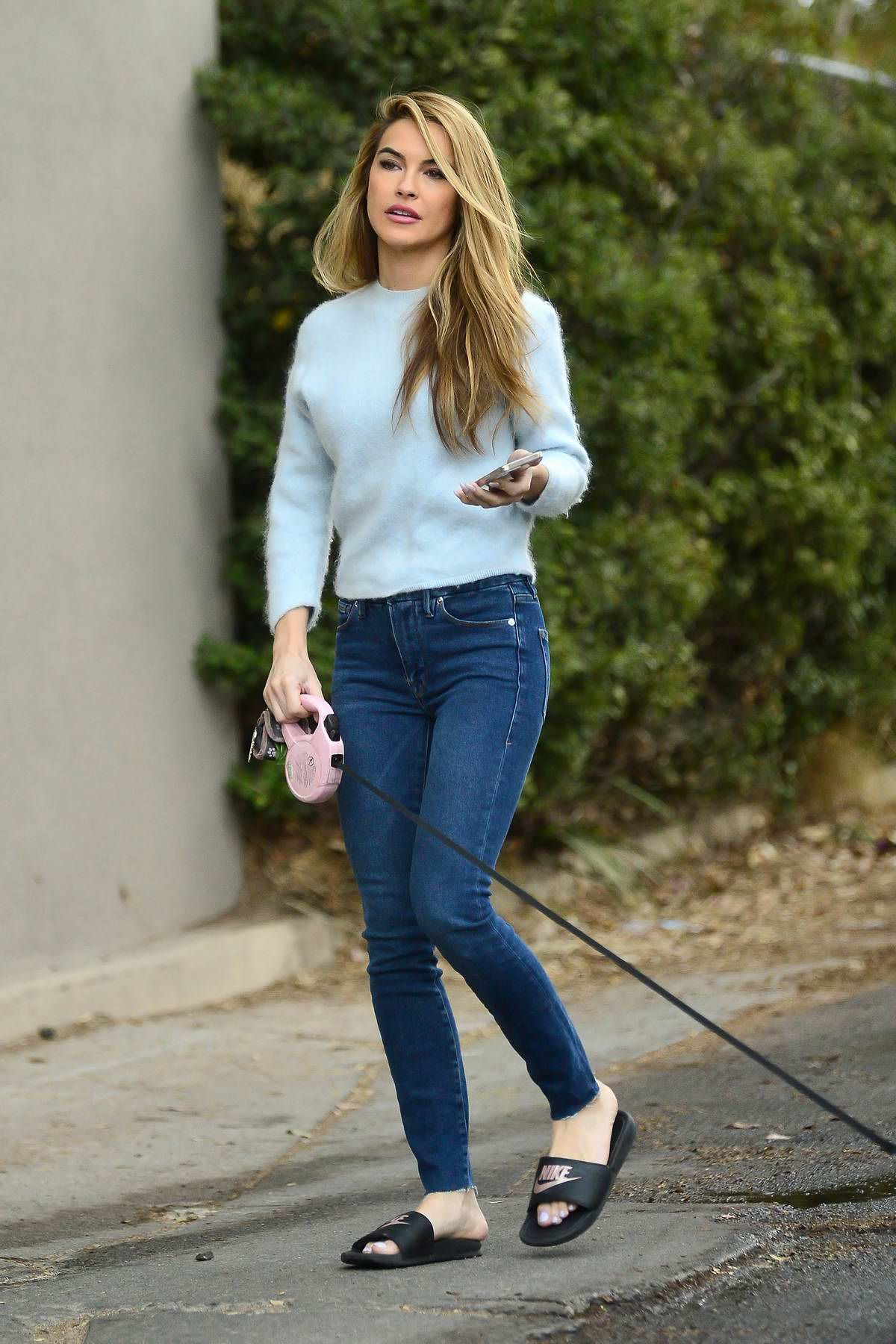 Chrishell Stause looks great in a light blue top and skinny jeans while out for a morning walk in the Hollywood Hills, California