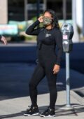 Christina Milian shows her baby bump in an all-black outfit while working at her Beignet Box in Los Angeles