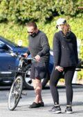 Christina Schwarzenegger enjoys bike ride with her dad Arnold Schwarzenegger in Santa Monica, California