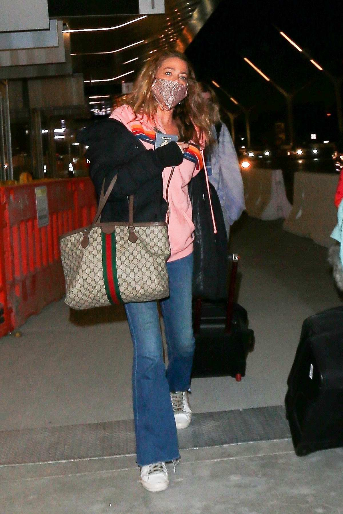 Denise Richards jets out of LAX with her family, Los Angeles