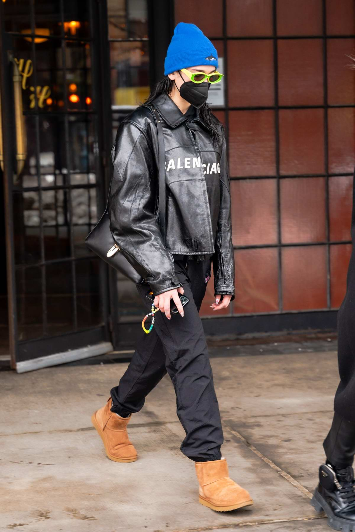 Dua Lipa bundles up in Balenciaga leather jacket paired with blue beanie and UGG boots as she heads out in New York City