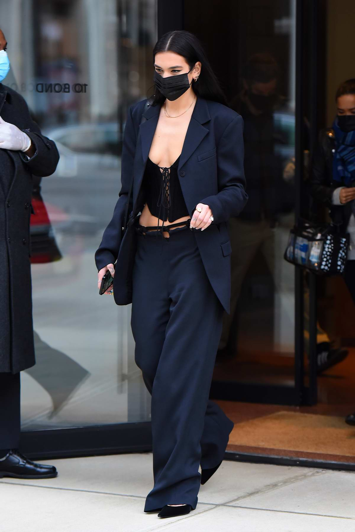 Dua Lipa looked sharp in a tailored black outfit as she stepped out in Manhattan, New York