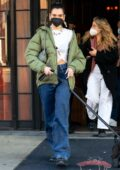 Dua Lipa looks trendy in a green puffer jacket and baggy denim as she heads out with her puppy in New York City