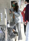 Eiza Gonzalez looks cool in denim jacket and striped pants while out to grab an iced-coffee in West Hollywood, California