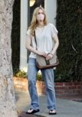 Elle Fanning keeps things casual with a tee and jeans while out for some Christmas shopping in West Hollywood, California
