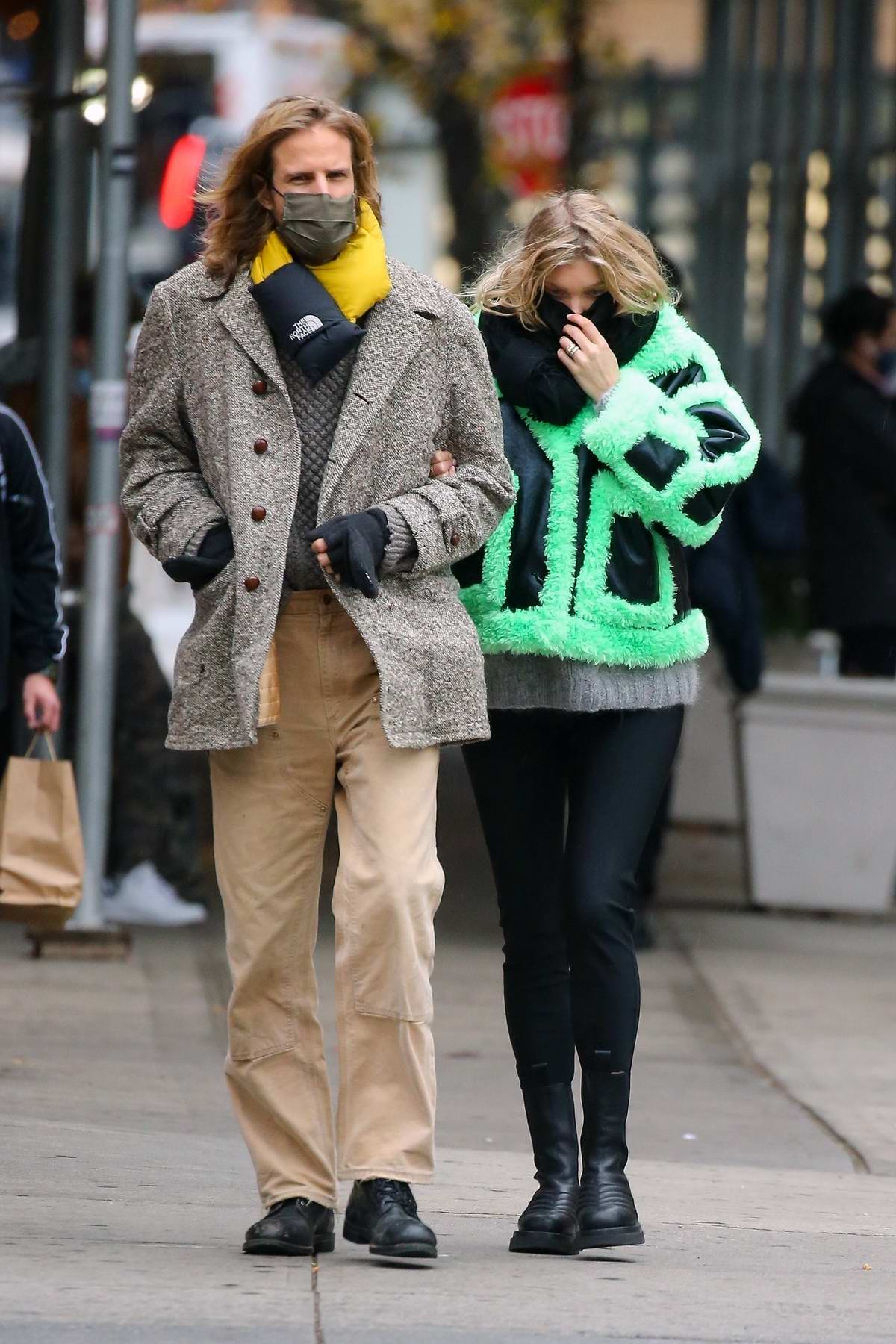 Elsa Hosk looks stylish in a green fur-lined jacket while out on a stroll with Tom Daly in New York City