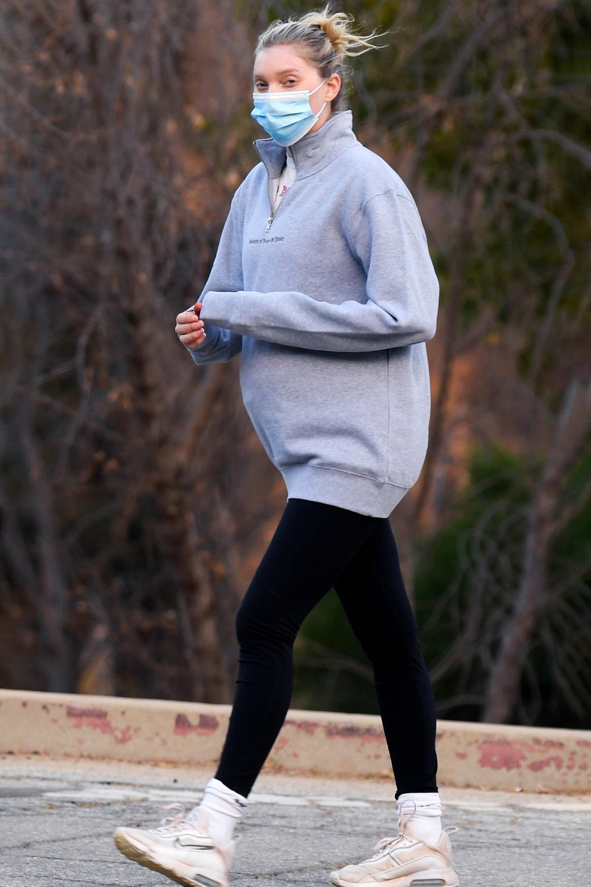 Elsa Hosk shows her growing baby bump while hiking with Tom Daly in Los Angeles