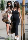 Emily Ratajkowski shows her baby bump in a form-fitting black dress while making a grocery run at Erewhon in Los Angeles