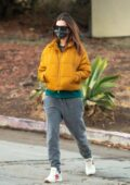 Emily Ratajkowski sports mustard yellow jacket and grey sweatpants as she takes a stroll with a friend in Los Angeles