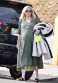 Emma Roberts steps out wearing a green dress as she heads to an appointment in Los Angeles