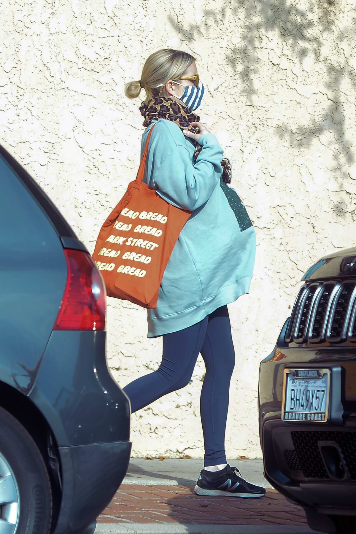 Emma Roberts wears a blue sweatshirt and navy leggings while running some errands in Los Angeles