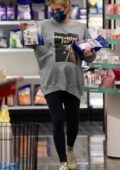 Emma Roberts wears a sweatshirt and leggings during her shopping trip to Target in Los Angeles
