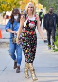 Gwen Stefani wears a cat themed Christmas jumpsuit as she heads into a studio in Santa Monica, California