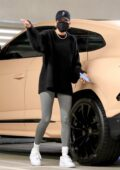 Hailey Bieber sports a black sweatshirt and grey leggings while visiting a medical building in Westwood, California