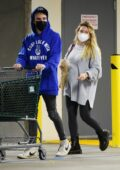 Hilary Duff sports an oversized sweatshirt and leggings during a grocery run with husband Matthew Koma in Los Angeles