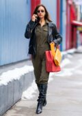 Irina Shayk looks stylish in a leather jacket with denim jumpsuit and knee-high boots while out in New York City
