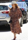 Isla Fisher steps out wearing a floral summer dress in Sydney, Australia