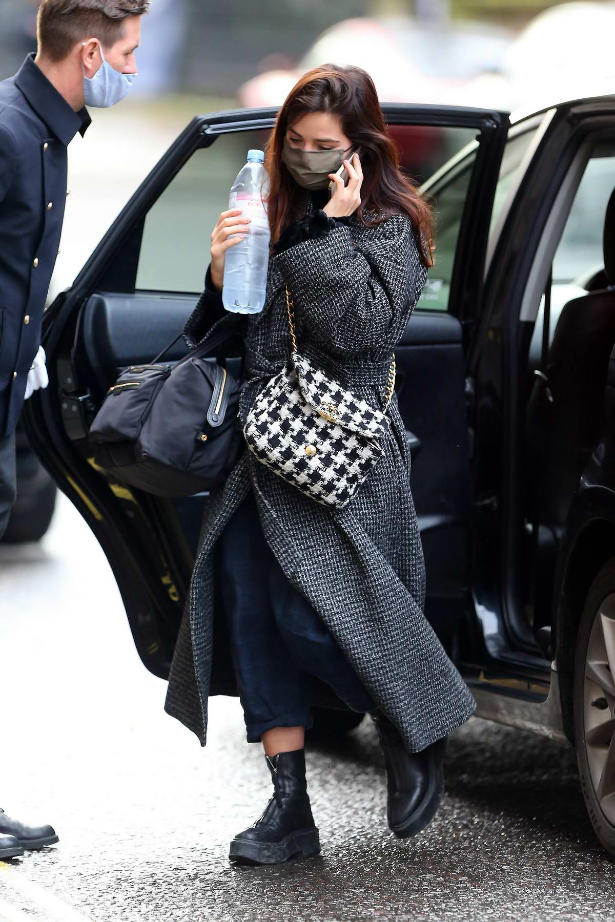 Jenna Coleman got her hands full as she steps out wearing a tweed coat in London, UK