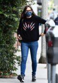 Jennifer Garner wears a black sweater and blue denim while running a few errands in Brentwood, California