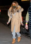 Jennifer Lopez bundles up in a fur-lined coat as she leaves a studio with Alex Rodriguez in New York City