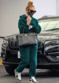 Jennifer Lopez keeps it casual yet chic in emerald green sweats while visiting a dermatologist in Beverly Hills, California