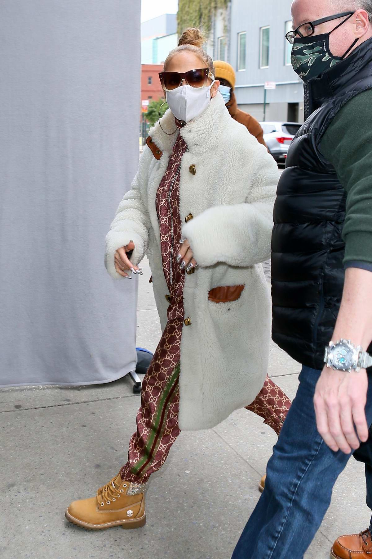 Jennifer Lopez looks cozy in a white teddy coat while heading into the studio in New York City