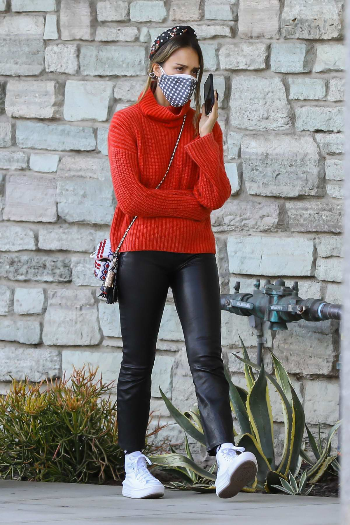 Jessica Alba looks great in a red turtleneck sweater and black leather pants while shopping at Target in Hollywood, California