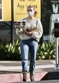 Julianne Hough keeps it casual with a sweater and jeans while making a morning coffee run in Los Angeles