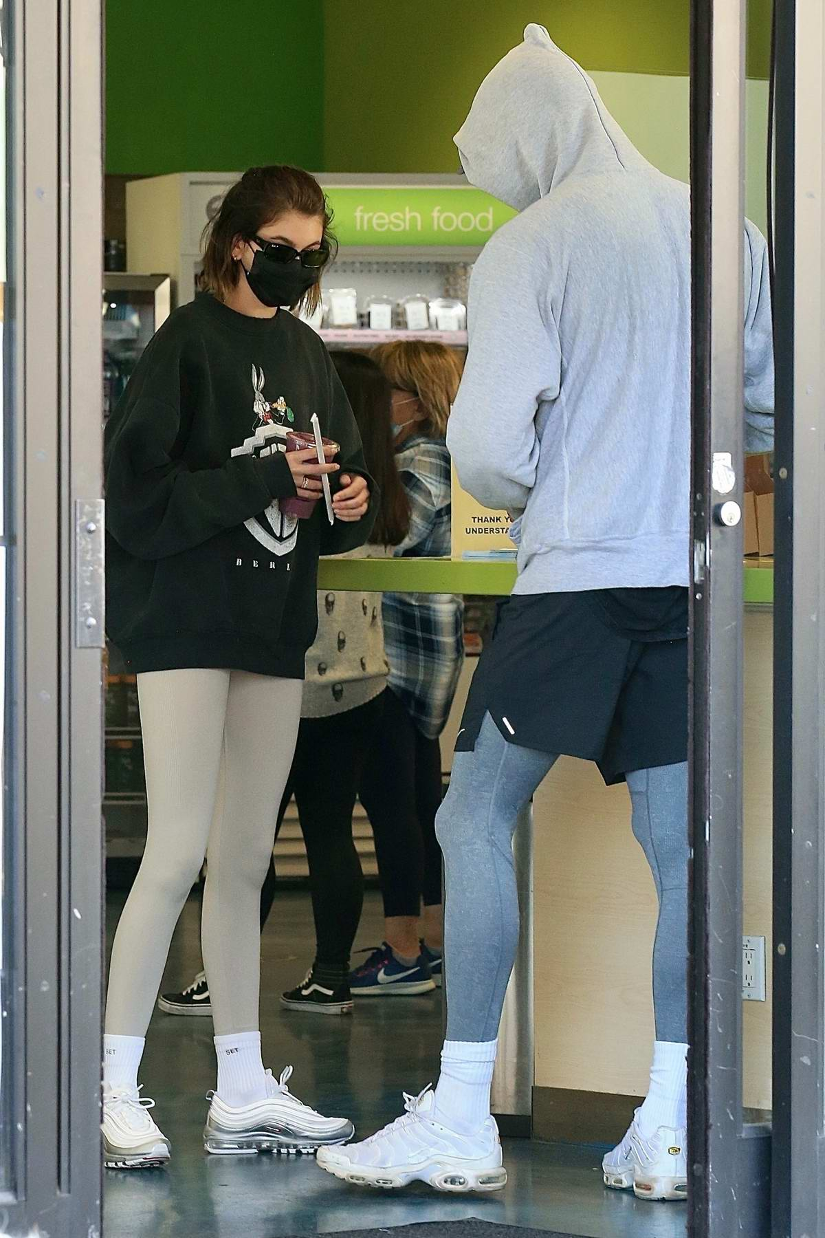 Kaia Gerber and Jacob Elordi keep a low profile as they grab some post-workout smoothies at Earthbar in Los Angeles