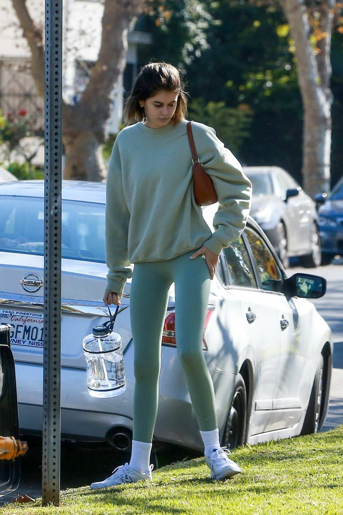 Kaia Gerber and Jacob Elordi seen arriving back to Jacob's place after a workout at Dogpound in West Hollywood, California