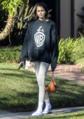 Kaia Gerber sports a sweatshirt and leggings while out on a walk with Jacob Elordi in Santa Monica, California