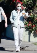 Kate Mara keeps it casual in grey sweatpants and denim jacket while making a coffee run with a friend in Los Feliz, California