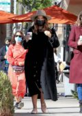 Katharine McPhee covers her baby bump with a long coat on a coffee and shopping outing with a friend in Beverly Hills, California