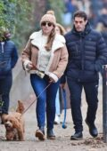 Kelly Brook and her partner Jeremy Parisi step out together to walk their dog in Primrose Hill, London, UK