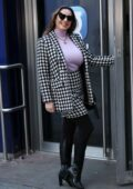 Kelly Brook dons a pink jumper and patterned outfit as she arrives at Heart radio in London, UK