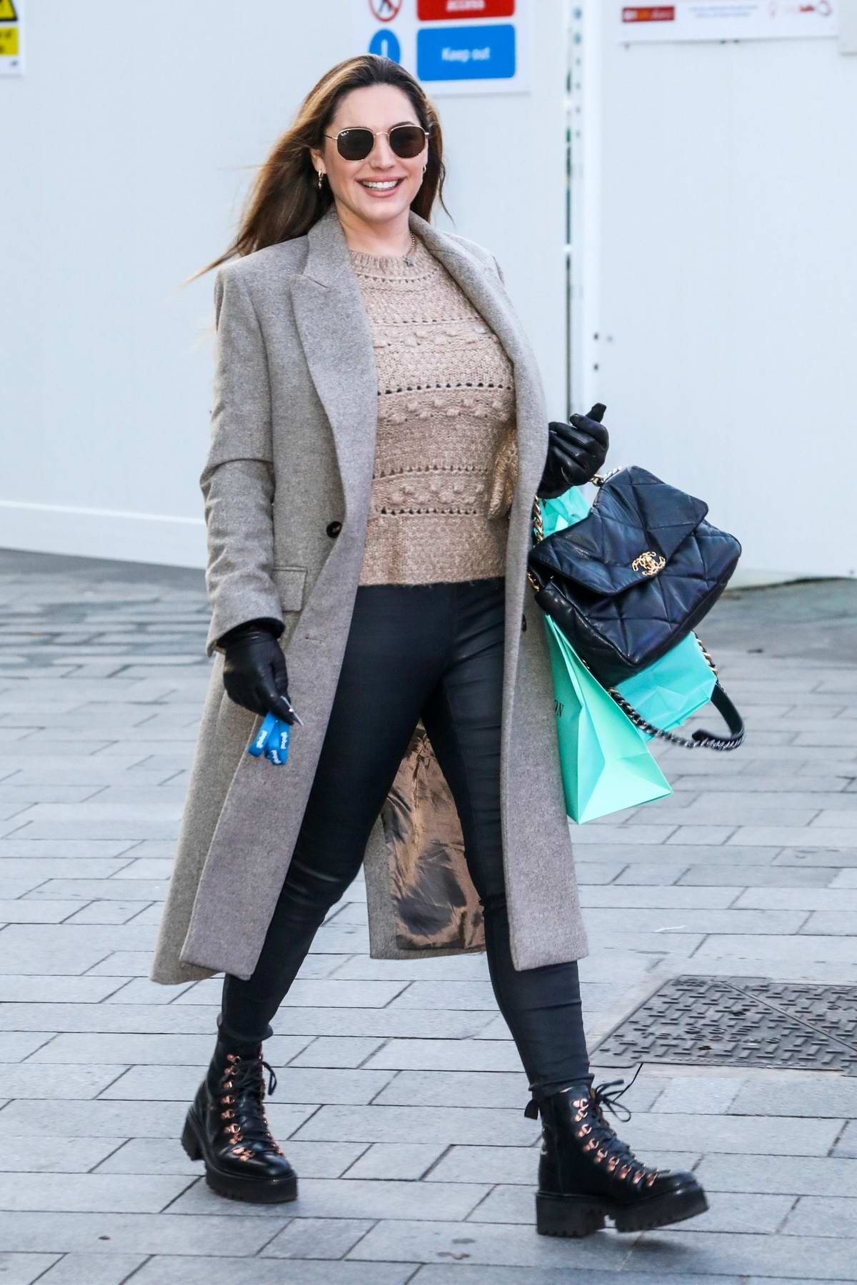 Kelly Brook flashes a big smile as she arrives at the Global Radio Studios in London, UK